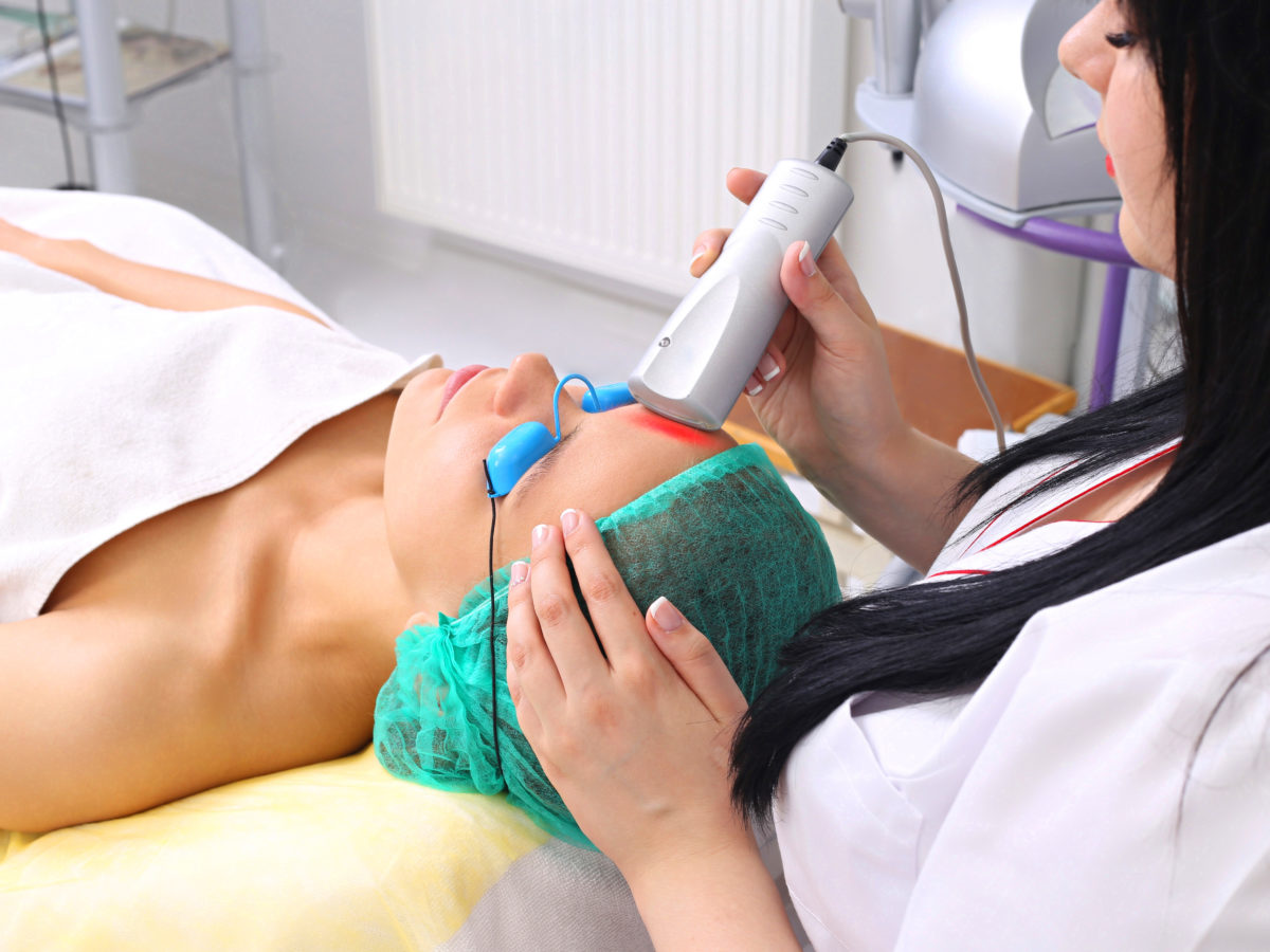 dermatologist performing a laser treatment for acne
