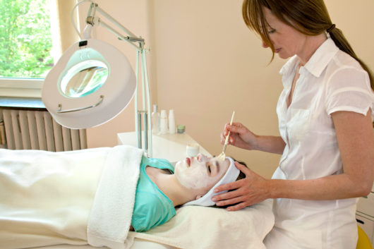 dermatologist or PA applying a chemical peel