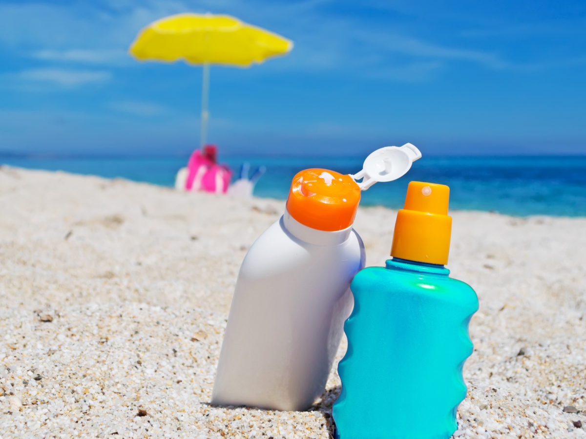 sunscreen bottles on the beach