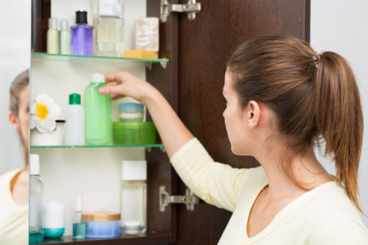 Choosing products from the bathroom cabinet