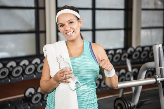 woman at the gym sweating